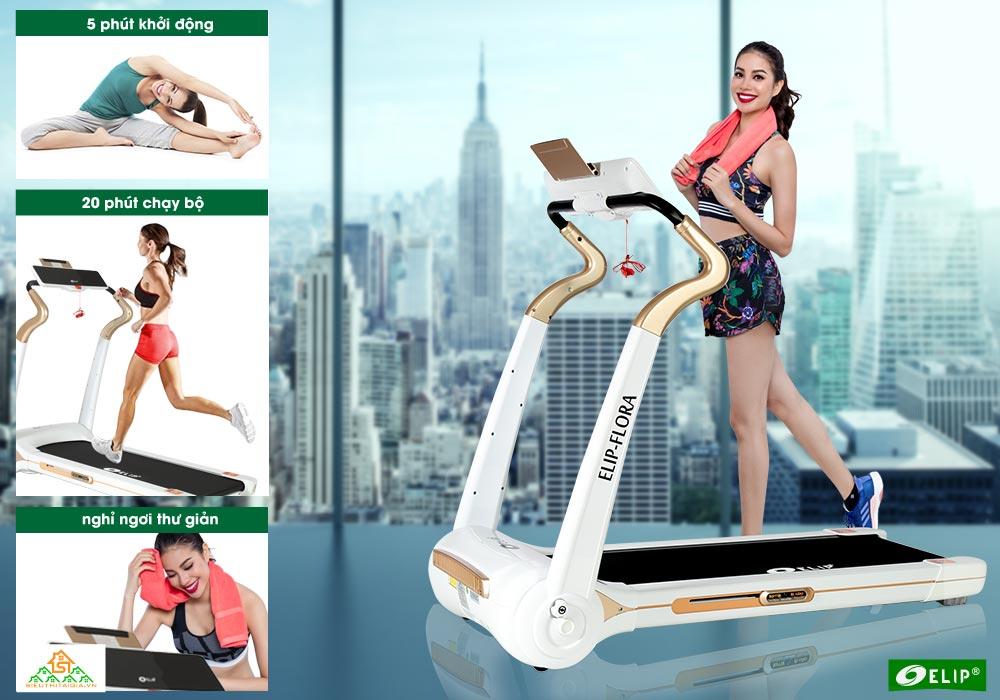 Phạm hương rèn luyện sức khỏe bên Máy chạy bộ điện Elip Flora